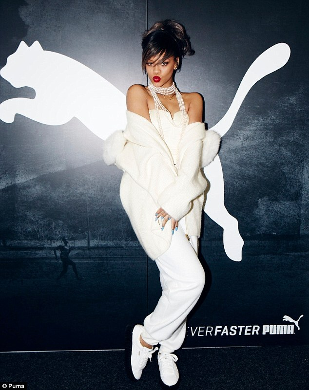 Meow! Rihanna posed with the Puma brand's signature logo at the brand's headquarters in Germany earlier today